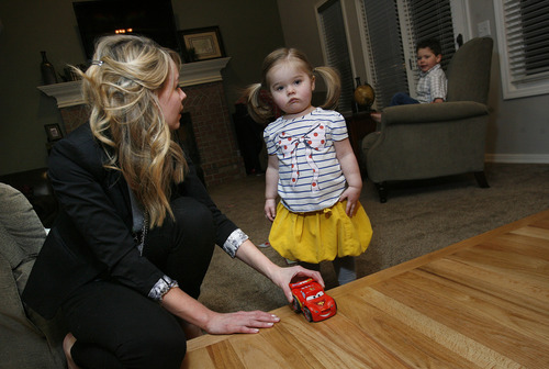 Scott Sommerdorf   |  The Salt Lake Tribune Anne Robertson is a mom who recently took a leave from work under the act to care for her infant. Here she plays with her daughter Kate, 1, at their home in Cottonwood Heights, Friday, February 8, 2013.