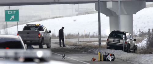 Al Hartmann  |  The Salt Lake Tribune Utah Highway Patrol investigates SUV at right in an apparent murder-suicide near the Redwood Road exit on eastbound I-80 Friday February 8.