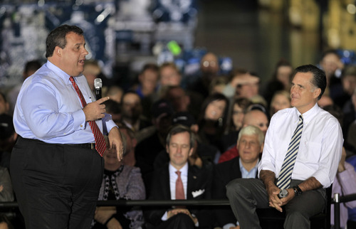 New Jersey Gov. Chris Christie, left, speaks as Republican presidential candidate, former Massachusetts Gov. Mitt Romney listens during a campaign stop at Ariel Corporation, Wednesday, Oct. 10, 2012, in Mount Vernon, Ohio. (AP Photo/Tony Dejak)
