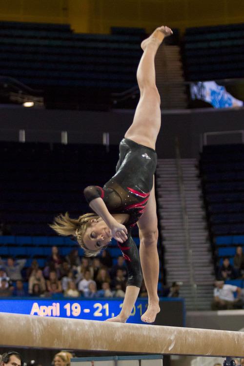 Junior Mary Beth Lofgren performs on the beam at UCLA Saturday, Jan. 12, 2013. Courtesy Nathan Sweet     Utah Athletics
