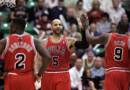 Kim Raff     The Salt Lake Tribune (left) Chicago Bulls power forward Carlos Boozer (5) slaps the hand of teammate (right) Chicago Bulls small forward Luol Deng (9) during the first half against the Utah Jazz at EnergySolutions Arena in Salt Lake City on February 8, 2013.