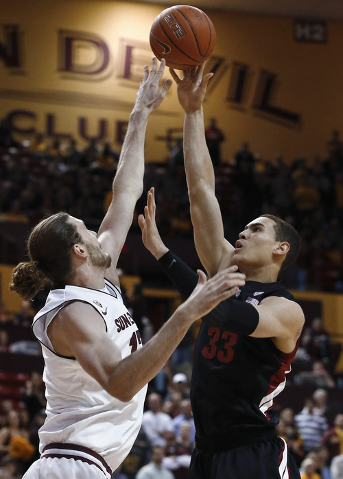 Stanford's Dwight Powell, right, scores over Arizona State's Jordan Bachynski during the first half of an NCAA college basketball game Saturday, Feb. 9, 2013, in Tempe, Ariz.  Stanford defeated Arizona State 62-59.(AP Photo/Ross D. Franklin)