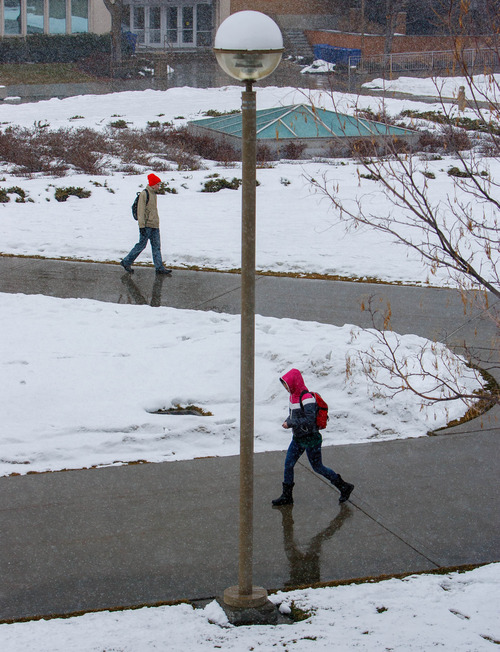 Trent Nelson  |  The Salt Lake Tribune Students walk through a light snowfall on the BYU campus Saturday, February 9, 2013 in Provo.