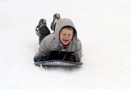 Rick Egan  | The Salt Lake Tribune   Joel Johnson, 7, sleds down a hill near Mueller Park Junior High, Saturday, February 9, 2013.