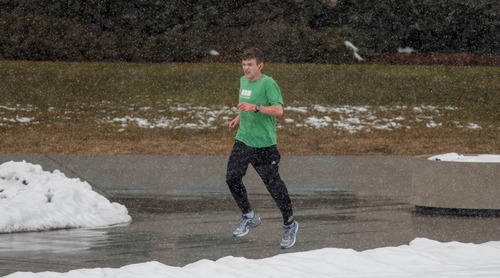 Trent Nelson  |  The Salt Lake Tribune A jogger runs through a light snowfall on the BYU campus Saturday, February 9, 2013 in Provo.