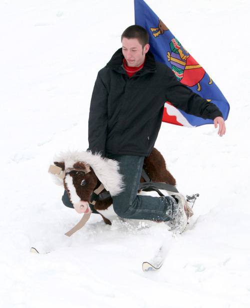 Rick Egan  | The Salt Lake Tribune   Hayden Lott attempts to slide down a hill on a sled made up of a stuffed horse on a pair of ski's, near Mueller Park Junior High,  in Bountiful, Saturday, February 9, 2013.