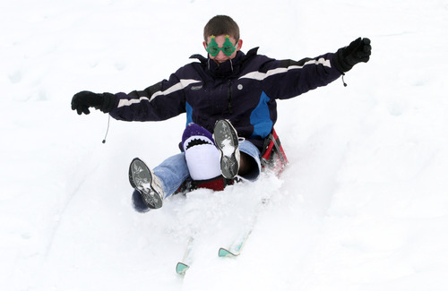 Rick Egan  | The Salt Lake Tribune   Jeremy Bergin goes down a hill near Mueller Park Junior High on a sled made of a suitcase on ski's, Saturday, February 9, 2013.