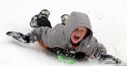 Rick Egan  |  The Salt Lake Tribune   Joel Johnson, 7, sleds down a hill near Mueller Park Junior High Bountiful Saturday, February 9, 2013.