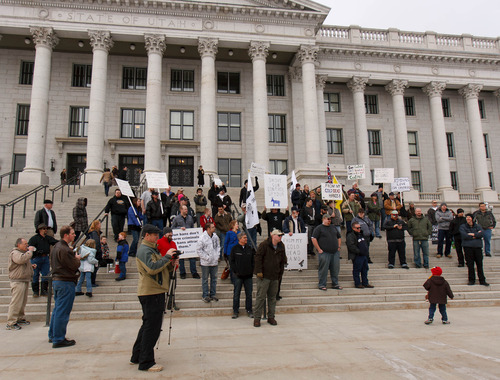 Trent Nelson  |  The Salt Lake Tribune Citizens at a gun rights rally on the steps of the state Capitol Friday, February 8, 2013 in Salt Lake City.