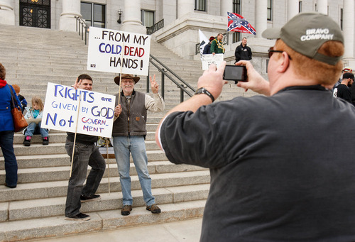 Trent Nelson  |  The Salt Lake Tribune Josh Harris and Dave Larson pose for a photograph (being taken by Joe Harris) at a gun rally on the steps of the state Capitol Friday, February 8, 2013 in Salt Lake City.