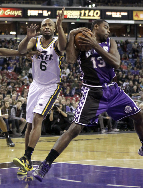 Sacramento Kings guard Tyreke Evans, right, intercepts a pass intended for Utah Jazz guard Jamaal Tinsley in the first quarter of an NBA basketball game in Sacramento, Calif., Saturday, Feb. 9, 2013. (AP Photo/Rich Pedroncelli)