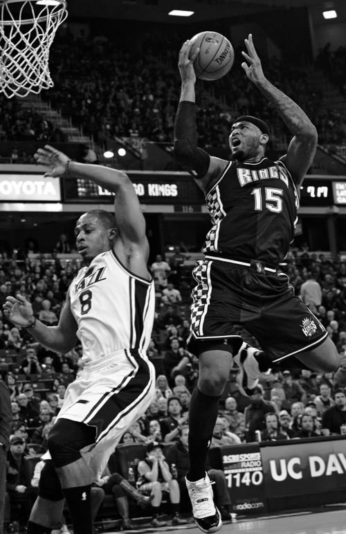 Sacramento Kings' center DeMarcus Cousins (15) scores  against the Utah Jazz during an NBA basketball game on Saturday, Feb. 9, 2013,  in Sacramento, Calif.  (AP Photo/The Sacramento Bee, Randall Benton) MAGS OUT; TV OUT (KCRA3, KXTV10, KOVR13, KUVS19, KMAZ31, KTXL40) MANDATORY CREDIT
