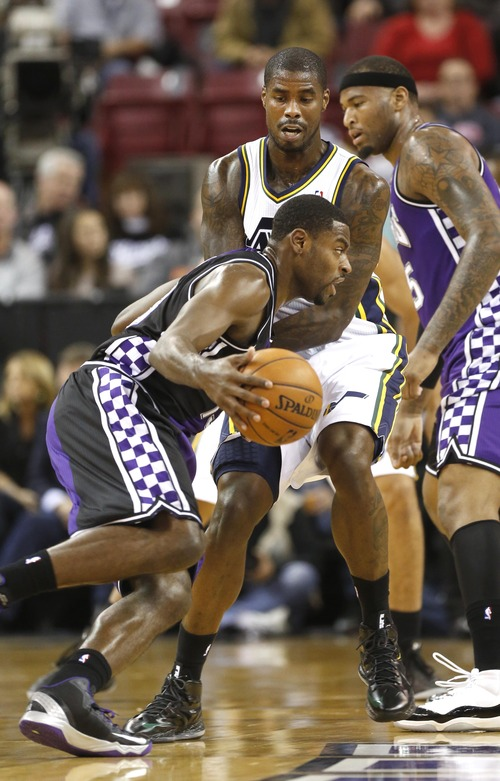 Sacramento Kings Tyreke Evans, left, tries to drive past Utah Jazz forward Marvin Williams in the first quarter of an NBA basketball game in Sacramento, Calif., Saturday, Feb. 9, 2013. (AP Photo/Rich Pedroncelli)