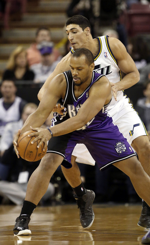 Sacramento Kings forward Chuck Hayes, left, protects the ball from Utah Jazz center Enes Kanter, of Turkey,  in the first quarter of an NBA basketball game in Sacramento, Calif., Saturday, Feb. 9, 2013. (AP Photo/Rich Pedroncelli)