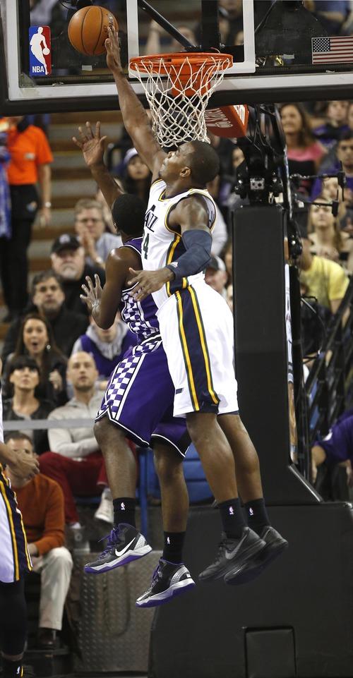 Utah Jazz forward Paul Milsap, right, blocks the shot of Sacramento Kings  guard Tyreke Evans during the first  quarter of an NBA basketball game in Sacramento, Calif., Saturday, Feb. 9, 2013. (AP Photo/Rich Pedroncelli)