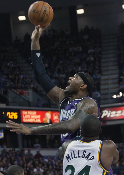 Sacramento Kings center DeMarcus Cousins (15) shoots against the Utah Jazz during an NBA basketball game on Saturday, Feb. 9, 2013,  in Sacramento, Calif.  (AP Photo/The Sacramento Bee, Randall Benton) MAGS OUT; TV OUT (KCRA3, KXTV10, KOVR13, KUVS19, KMAZ31, KTXL40) MANDATORY CREDIT