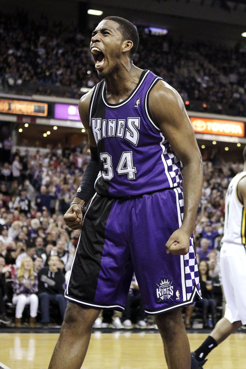 Sacramento Kings  forward Jason Thompson reacts after scoring and getting fouled by the Utah Jazz in the fourth quarter of their NBA basketball game in Sacramento, Calif., Saturday, Feb. 9, 2013. The Kings won 120-109. (AP Photo/Rich Pedroncelli)
