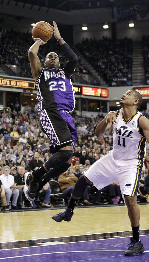 Sacramento Kings  guard Marcus Thornton (23) shoots over Utah Jazz guard Earl Watson in the fourth quarter of an NBA basketball game in Sacramento, Calif., Saturday, Feb. 9, 2013. The Kings won 120-109. (AP Photo/Rich Pedroncelli)