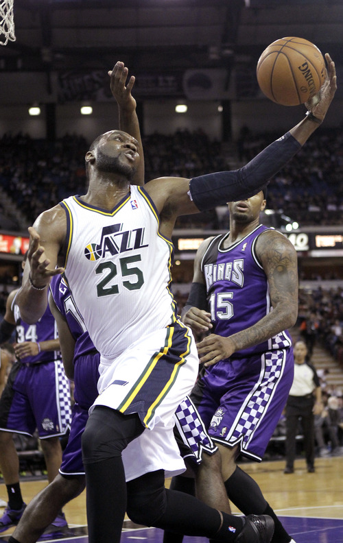 Utah Jazz  center Al Jefferson, left, grabs the rebound in front of Sacramento Kings center DeMarcus Cousins, right, during  the first quarter of an NBA basketball game in Sacramento, Calif., Saturday, Feb. 9, 2013. (AP Photo/Rich Pedroncelli)
