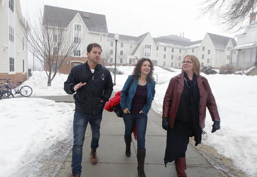 Al Hartmann  |  The Salt Lake Tribune Brad Rasmussen, left, and Carine Henderson of My Convention Housing, take a walking tour of the University of Utah's residence halls with Marci Healy, assistant director of summer conferences at the U.'s Guest House and Conference Center. Rasmussen and Henderson are arranging to supply 1,000 beds at the former Olympic Village to the Outdoor Retailer Summer Market trade show.
