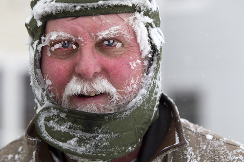 Ice clings to Ken Anderson's eyebrows and mustache as he uses a snowblower during a blizzard, Saturday, Feb. 9, 2013, in Portland, Maine. The storm dumped more than 30 inches of snow as of Saturday afternoon, breaking the record for the biggest storm on record. (AP Photo/Robert F. Bukaty)