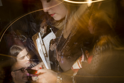 In this photo made with multiple flash exposures, a group of models, journalists, and workers wait backstage before the Jill Stuart Fall 2013 collection is shown at the Mercedes-Benz Fashion Week tents at Lincoln Center, Saturday, Feb. 9, 2013, in New York. (AP Photo/John Minchillo)