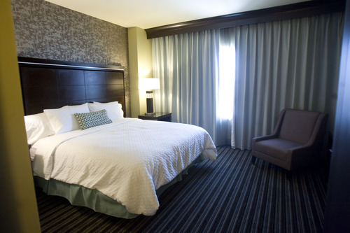 Kim Raff     The Salt Lake Tribune A traditional room with a king-size bed in the newly constructed Embassy Suites in West Valley City.