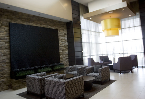 Kim Raff     The Salt Lake Tribune The sitting areas in the lobby of the Embassy Suites in West Valley City's Fairbourne Station.