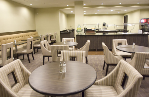 Kim Raff     The Salt Lake Tribune The breakfast area of the Embassy Suites in West Valley City. The hotel is a cornerstone of the Fairbourne Station development in West Valley City.