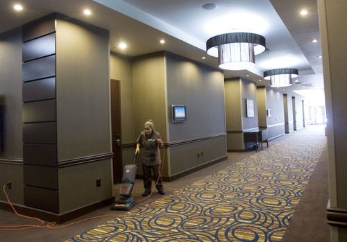 Kim Raff     The Salt Lake Tribune A hotel employee vacuums a hallway in the  Embassy Suites in West Valley City. The hotel is a cornerstone of the Fairbourne Station development.