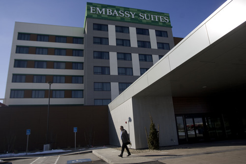 Kim Raff     The Salt Lake Tribune A hotel guest walks out of the newly constructed Embassy Suites in West Valley City on Monday, Feb. 11, 2013. The hotel is a cornerstone of the Fairbourne Station development in West Valley City.