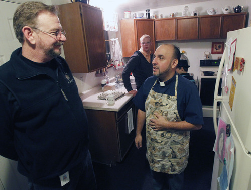 Al Hartmann  |  The Salt Lake Tribune Mark Dexheimer-Trujillo, left, and his partner, the Rev. Robert Trujillo, talk in the kitchen as they get their children ready for work and school. Trujillo can legally marry people but can't get married himself to his longtime partner, Mark.