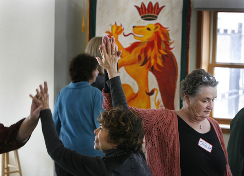 Scott Sommerdorf   |  The Salt Lake Tribune Carla Kelley, right, takes part in an activity during a workshop put on by the Human Rights Education group to teach people how to find common ground even when divided over religion in Deans Hall at St. Marks Episcopal Church, Saturday, February 9, 2013.