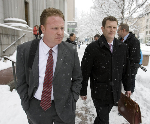 Paul Fraughton  |   Salt Lake Tribune Jeremy Johnson, left, leaves the federal court building in Salt Lake City with his lawyer Nathan Crane on Friday, January 11, 2013