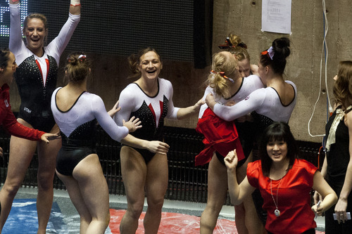 Chris Detrick  |  The Salt Lake Tribune Utah's Tory Wilson celebrates with her teammates after competing on the vault during the meet against Arizona State at the Huntsman Center Friday February 1, 2013. Utah won 196.425 to 195.450. Wilson won the event with a score of 9.975.