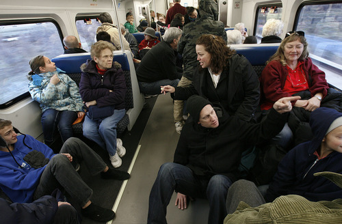Scott Sommerdorf  |  Tribune file photo              Rob Jones, seated on floor, and Lori Jones, above him, talk with other riders as they took the free ride from Provo to Salt Lake City on the new FrontRunner train on Saturday. Regular service began Monday and complaints about the new line -- from broken ticket machines to late trains and glitchy Wi-Fi -- are plentiful.