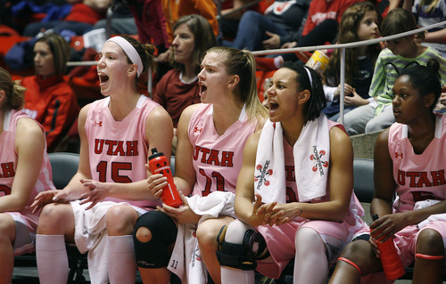Scott Sommerdorf   |  The Salt Lake Tribune Utah starters Michelle Plouffe, left, Taryn Wicijowski, center, along with Ciera Dunbar, and Cheyenne Wilson, far right, cheer on the rest of the team as they finish out the game. Utah beat Oregon State 66-40, Sunday, February 10, 2013.
