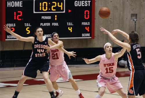 Scott Sommerdorf   |  The Salt Lake Tribune Utah's stifling defense helped them to a 12-0 first half run before OSU managed a score. Here, Chelsea Bridgewater, 21, and Michelle Plouffe, 15, defend. Utah beat Oregon State 66-40, Sunday, February 10, 2013.