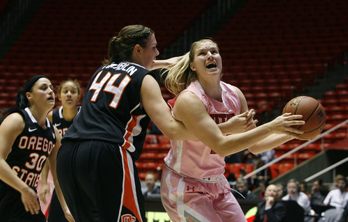 Scott Sommerdorf   |  The Salt Lake Tribune Utah's Taryn Wicijowski is fouled as she goes tot he basket by OSU's Ruth Hamblin during second half play. Utah beat Oregon State 66-40, Sunday, February 10, 2013.