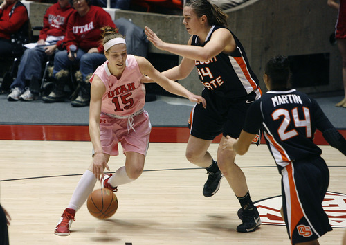 Scott Sommerdorf   |  The Salt Lake Tribune Utah's Michelle Plouffe, 15, drives on OSU's Ruth Hamblin during first half play. Utah beat Oregon State 66-40, Sunday, February 10, 2013.