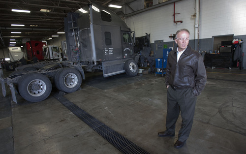 Steve Griffin | The Salt Lake Tribune   Bart Warner, of the Warner Truck Center in West Valley City, Utah, stands in one of their truck repair areas Thursday January 10, 2013. The truck center is home to transportation-related businesses that sell, maintain, repair and customize heavy- and light-duty vehicles,