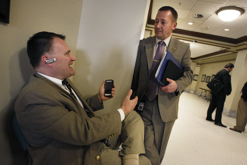Scott Sommerdorf   |  The Salt Lake Tribune Clark Aposhian, left, speaks with Representative Paul Ray, R-Clearfield, after Ray walked over to see him in the House building at the Utah State Capitol complex, Wednesday, February 6, 2013. Aposhian spends long days at the capitol every day during the legislative session advocating for gun rights, and often legislators stop by to speak with him about gun issues.