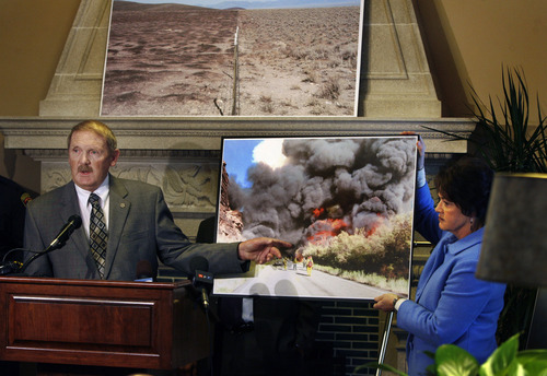 Scott Sommerdorf   |  The Salt Lake Tribune Dick Buehler, director of the Utah Division of Forestry, Fire and State Lands, speaks as Sen. Margaret Dayton, R-Orem, holds up a photo of a fire during a news conference about wildfire bills SB120 and SB62 in the Senate Lounge, Thursday, February 7, 2013.