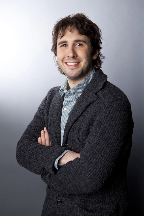 "In this Jan. 3, 2013 photo, American singer Josh Groban poses for a portrait in New York. Groban is releasing his sixth album, ""All That Echoes,"" which was produced by Rob Cavallo, who is best known for producing for Green Day. (Photo by Amy Sussman/Invision/AP)"