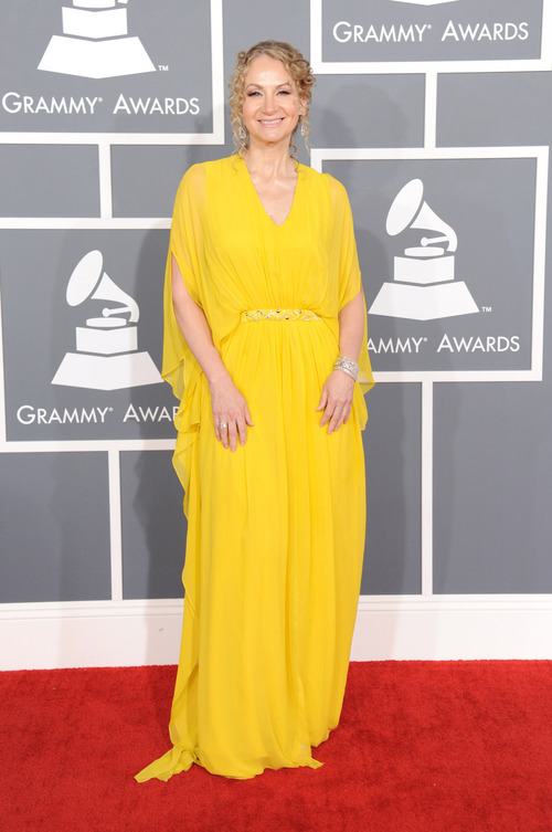 Blues artist Joan Osborne arrives at the 55th annual Grammy Awards on Sunday, Feb. 10, 2013, in Los Angeles.  (Photo by Jordan Strauss/Invision/AP)
