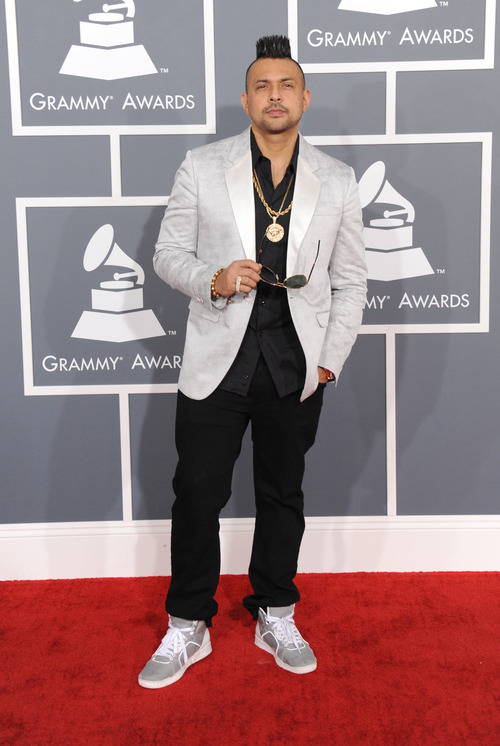Sean Paul arrives at the 55th annual Grammy Awards on Sunday, Feb. 10, 2013, in Los Angeles.  (Photo by Jordan Strauss/Invision/AP)