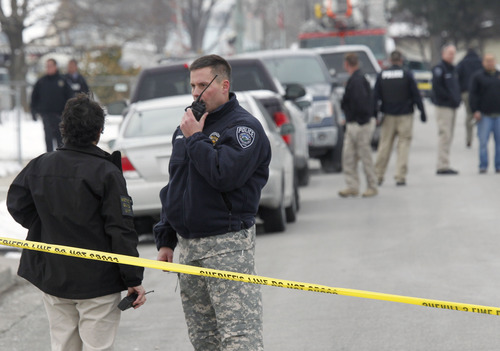 Al Hartmann  |  The Salt Lake Tribune Unified Police officers investigate a triple homicide at 8286 S. 450 West (Adams Street) in Midvale on Tuesday, Feb, 12.   Up to 80 officers were involved in a manhunt for a male suspect.