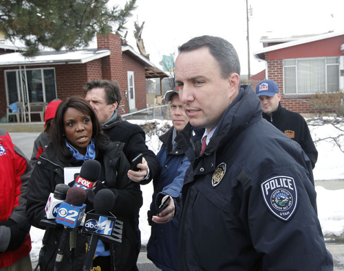 Al Hartmann  |  The Salt Lake Tribune Unified Police Lt. Justin Hoyal says that the triple homicide David Fresques, a person of interest is still at large noon February 12.   Up to 80 officers are involved in a manhunt of the area for a male suspect.