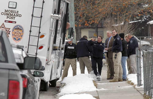 Al Hartmann  |  The Salt Lake Tribune Unified Police officers investigate a triple homicide at 8286 South 450 West (Adams Street) in Midvale Tuesday February 12.   Up to 80 officers were involved in a manhunt of the area for a male suspect.