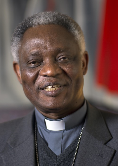 ADD FEB. 12 IN BODY OF CAPTION - Ghanian Cardinal Peter Kodwo Appiah Turkson talks during an interview with the Associated Press, in Rome, Tuesday, Feb. 12, 2013. The resignation of Pope Benedict XVI opens the door to a host of possible successors, from the cardinal of Milan to a contender from Ghana and several Latin Americans. (AP Photo/Domenico Stinellis)